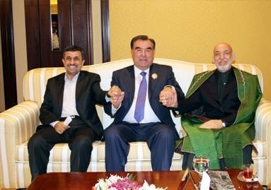 Presidents Maḥmūd Aḥmadī-nezhād, Emōm-ʿAlī Raḥmōn, and Ḥāmid Karzay of Iran, Tajikistan, and Afghanistan meeting in Kuwait, 2012.