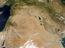 Satellite image of the Middle East, with super-imposed political borders. The Sawād is visible as the dark expanse of land in south-central Iraq.