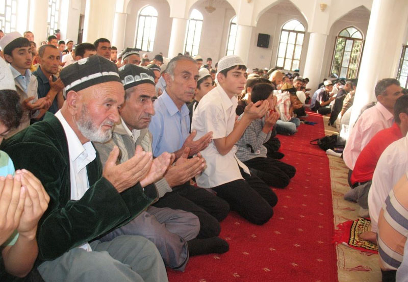 Tajiks praying in the central mosque of Dushanbe, 2010.